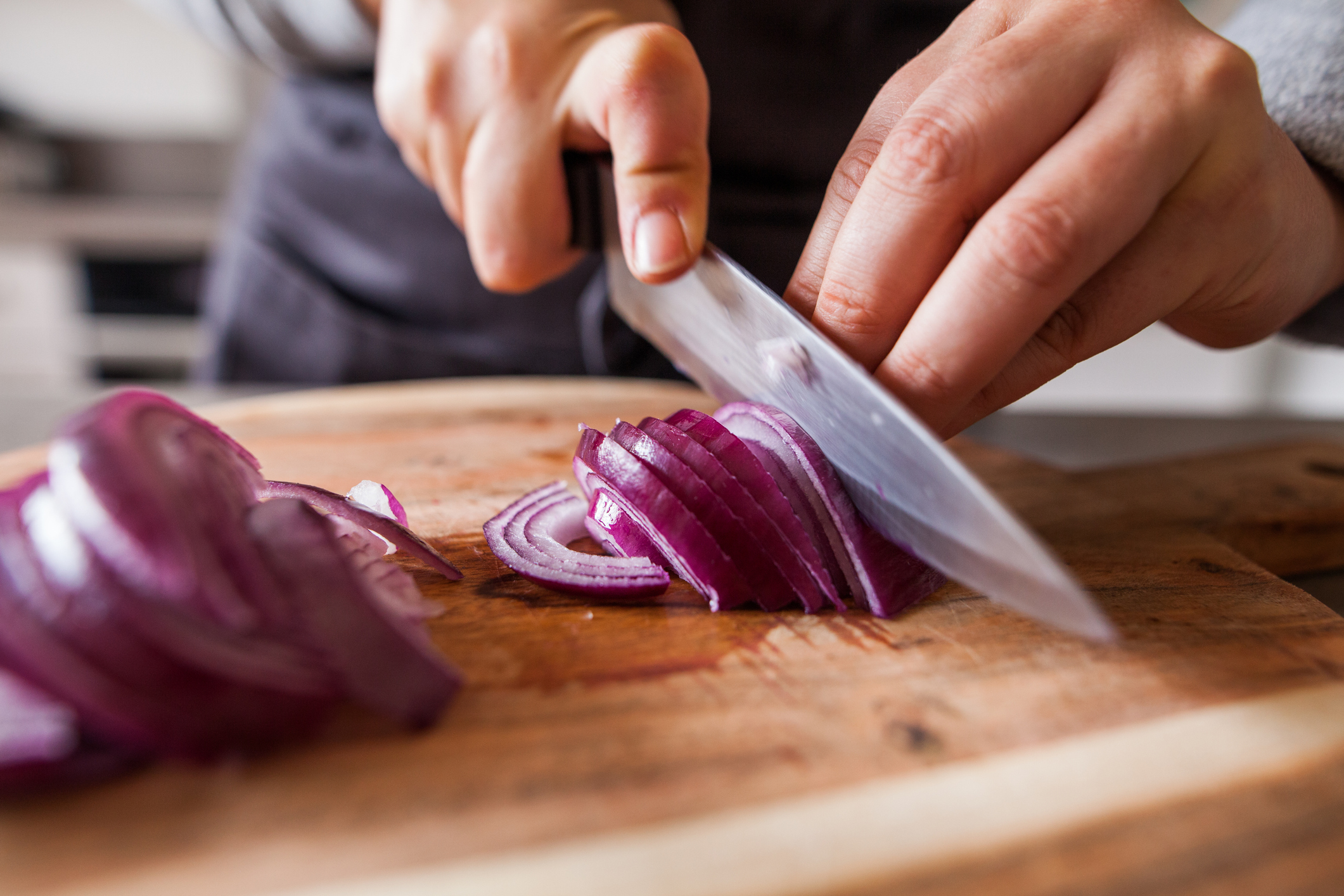 cutting onions on board